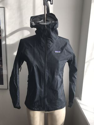 Patagonia Nylon Zip Up Jacket w/ Hood Size XS Black Women's Rain. Condition is Pre-owned. Some peeling inside of hood, but great condition otherwise. for Sale in Queens, NY