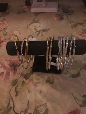 Women ear ring silver and gold and then three dollars for Sale in Las Vegas, NV