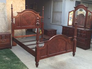 Queen bed set come with one long dresser and two nightstands in good condition all drawers open fine. for Sale in Fresno, CA
