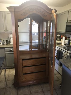 Beautiful Solid wood cabinet with light from HAVERTYS furniture for Sale in Keller, TX