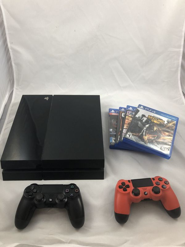 PS4 with 2 Controllers and 4 Video Games