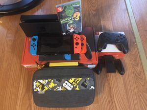Nintendo switch v2 with pro controller and carrying case along with 5 games! for Sale in Wylie, TX