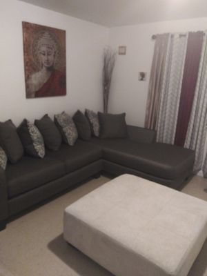 Rooms to go Sectional and ottoment for Sale in New Orleans, LA