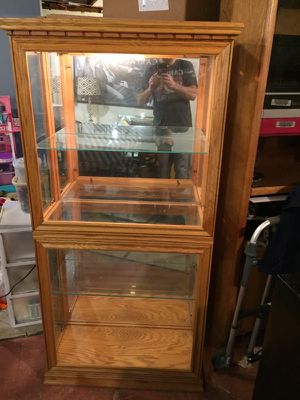 Solid oak lighted curio cabinet for Sale in Groveland, MA