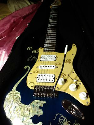 Rare high end stratocaster guitar with tremolo and hard-shell case for Sale in Las Vegas, NV
