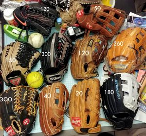 PRICES Marked on each Baseball and softball gloves OUTFIELD size wilson Rawlings mizuno Easton Louisville slugger for Sale in Houston, TX