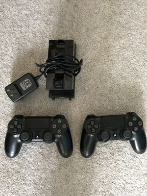 Two PS4 wireless controller and charging dock for Sale in Marysville, WA