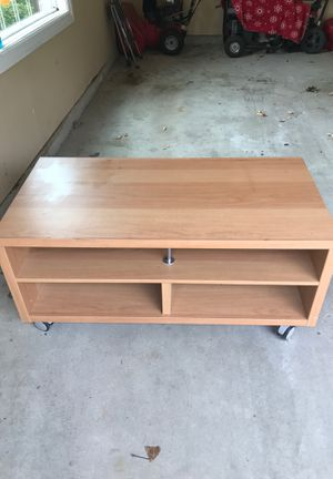 Very nice tv table with rolling wheels heavy duty for Sale in Lockport, IL