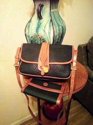 Vintage Dooney & Bourke black and tan pebbled genuine leather buckled front flap medium messenger crossbody shoulder bag purse AND wallet for Sale in Phoenix, AZ