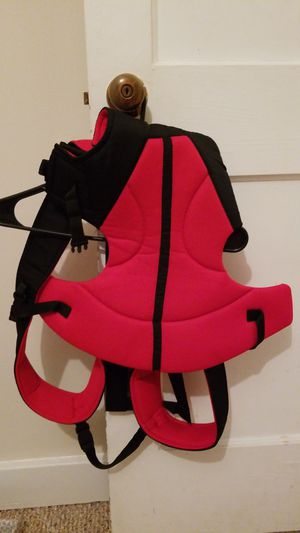 Red and black lightweight Baby carrier for Sale in Tampa, FL