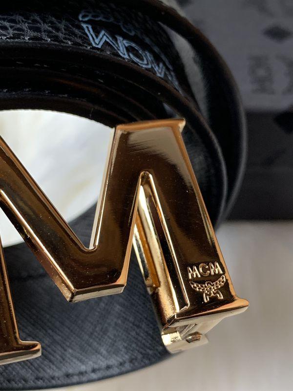 Black belt gold buckle