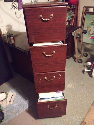 Four draw file cabinet on roller it have a few marks on the side i tape the draws up when i was moving so when i took the tape off for Sale in Stockbridge, GA