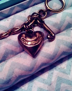 Juicy couture gold plated charm braclet for Sale in Dallas, TX