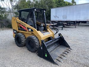 Bobcat dump truck skid steer grading for Sale in Ontario, CA