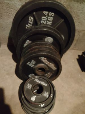 205 lbs olympic weights + 2 Olympic bars for Sale in Phoenix, AZ