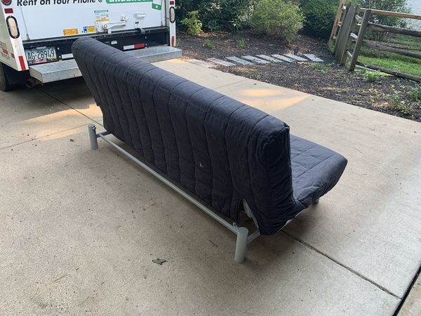 Futon. Folding couch and queen bed. Cover included