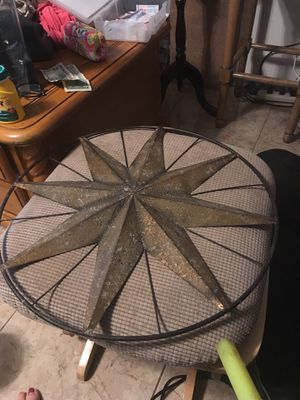 Star might be made of metal star for the garden house pool yard for Sale in Kissimmee, FL