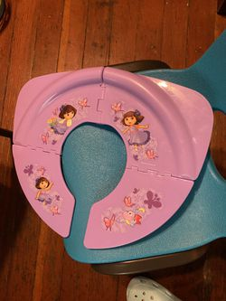 Make An Offer Dora foldable potty seat delivery for Sale in Los Angeles,  CA
