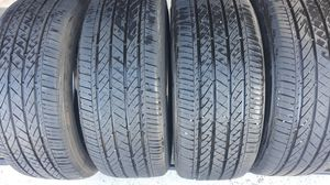 4 - TIRES - 235/45R18 BRIDGESTON TURANZA , TIRES FROM 2018 1 WITH PLUG. TREAD REMAINING ABOUT 75-80 %. for Sale in Henderson, NV