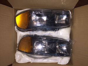 Brand New Never Used GMC Sierra Headlights Fits 99-07 for Sale in Winter Park, FL