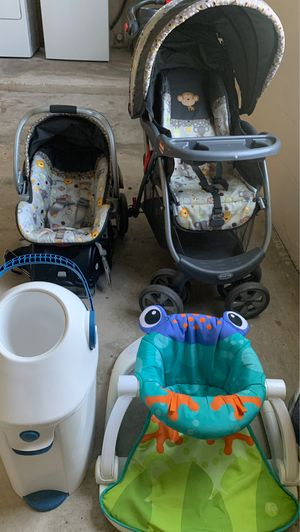 Car seat stroller and a baby toys for Sale in Dunnellon, FL