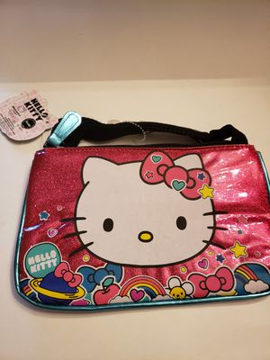 "Hello kitty colorful with sun face, rainbow purse 5 1 1/2"" x 8 1/2"" for Sale in Plainville, CT"
