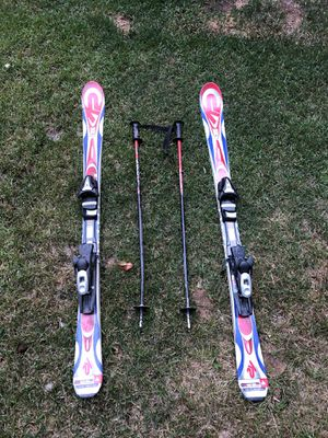 set of skis with boots,poles,helmet,and goggles for Sale in Mancelona, MI