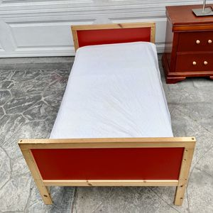 Red wooden toddler bed $20, mattress $10. for Sale in Long Beach, CA