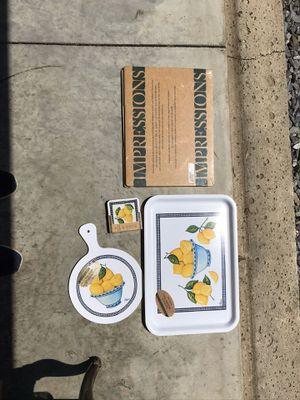 Impressions placemats (unopened) tray, coasters (unopened) and cutting board for Sale in Lynchburg, VA