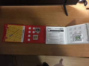 Three 3DS Games - Two in Original Case with Manual, One Not in Original Case (Super Mario Bros. 2, Luigi's Mansion Dark Moon, Yoshi's New Island) for Sale in Springfield, MO
