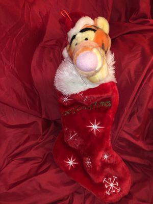 Disney Winnie the Pooh (Tigger) plush Christmas stocking ! Santa is wearing a red Santa Claus hat! This is battery operated plush Christmas stocking for Sale in Phoenix, AZ