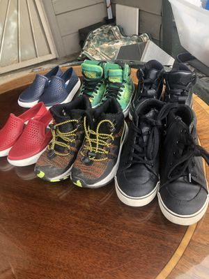 6 pairs of shoes size 11-12 and 1 in kids vans Jordan's all good condition all six for $10 for Sale in Palmdale, CA