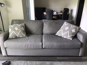 Grey couch for Sale in Baltimore, MD