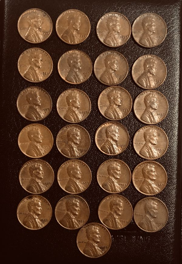 Lot 25 coins: Wheat penny's 1957 D