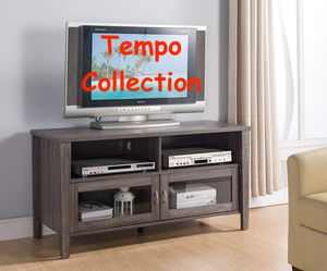 NEW IN THE BOX. MELINA 2 GLASS DOOR TV STAND UP TO 55IN TVS, DISTRESSED GREY , SKU# TC161566D for Sale in Santa Ana, CA