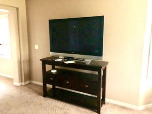 dark wood , tall console with 2 shelves and 3 middle drawers for storage for Sale in Chula Vista, CA
