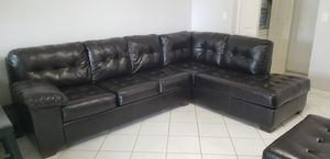 Black leather sectional couch with matching ottoman for Sale in Miramar, FL