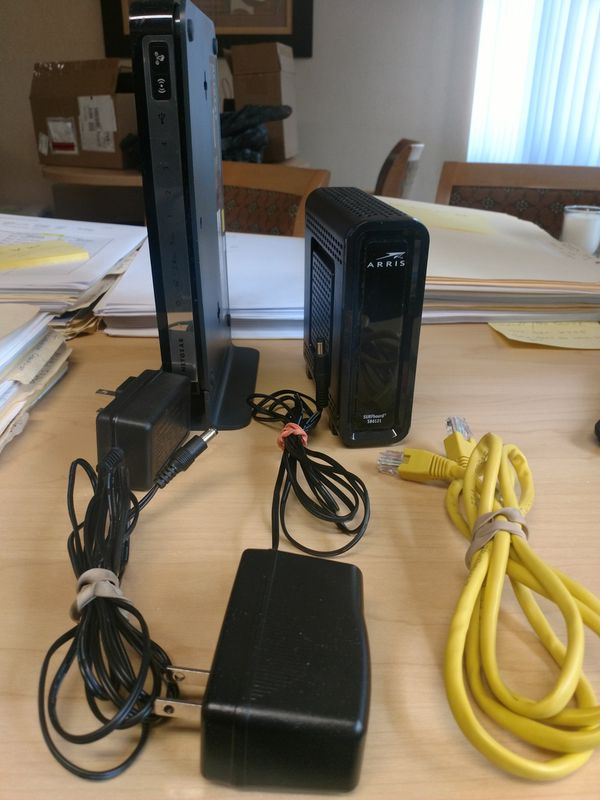 ARRIS SURFboard Cable Modem and NETGEAR N750 Wireless Dual Band Gigabit Router. Like new! $175