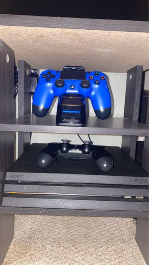 PS4 Pro with 2 Controllers plus a controller charging station & Astro a50 gaming headphones for Sale in San Diego, CA