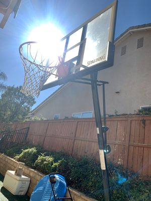"55"" Spaulding /NBA glass basketball hoop Adjustable. for Sale in Corona, CA"