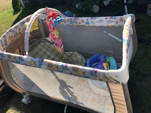Crib, car seat, and a chair with toys attached for Sale in Bow, WA