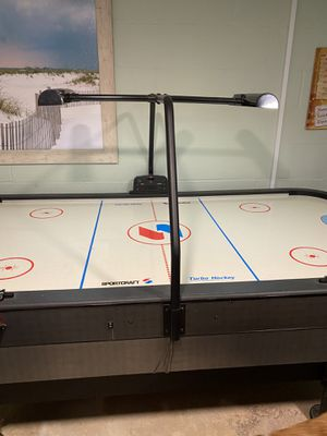 Sportcraft arcade style air hockey table, excellent shape, electronic lights and scoring, all pieces with it for Sale in Sharon, PA