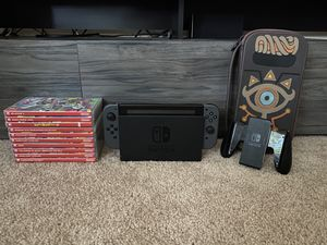 Nintendo Switch plus ten games and SPECIAL EDITION Breath of the Wild case for Sale in Ashburn, VA
