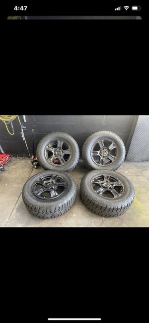 (4) Toyota Tundra sequoia 5 lugs wheels rims Oem black new tires for Sale in Alhambra, CA
