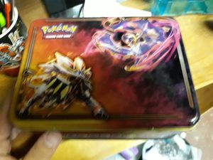 Tin and random pokemon and yugioh cards for Sale in Torrance, CA