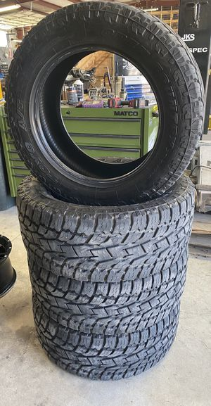 "(4) LT 295/55/20 Toyo A/T II tires w/ 75% tread left on them 33"" tall for Sale in Victoria, TX"