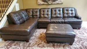 Mercer brown leather sectional couch with storage ottoman for Sale in Maple Valley, WA