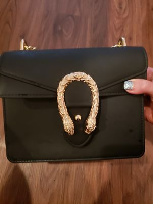 Black rubbery neoprene purse with gold details and chain for Sale in Houston, TX
