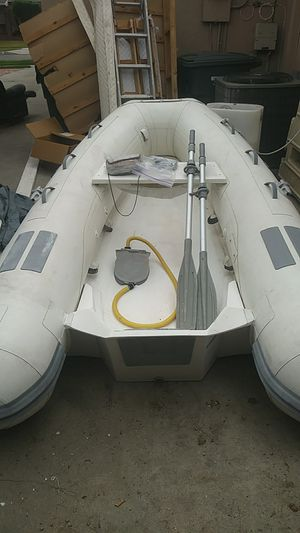 Inflatable boat+ motor for Sale in Lakewood, CA