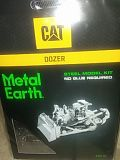And new Cat dozer metal Earth 3 sheet model kit for Sale in Orlando, FL